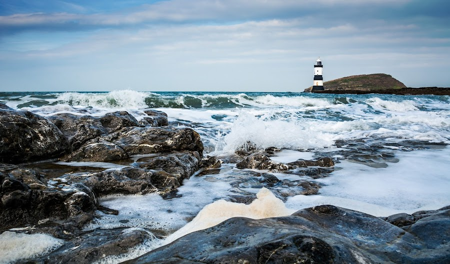 Rocky Surf by Mike Shields - Landscapes Waterscapes ( water, penmon point, lighthouse, sea, surf, rocks, puffin island )