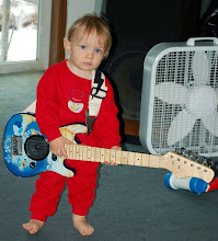 Photo: He's only 20 months old but he knows what to do with a guitar! Look, he already has a fan!