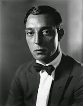 Photo: Even comedy star Buster Keaton is shiny, beautifully lit, his head modeled with highlights and shadows, his eyes directly engaging us.  Only the presence of shiny skin and the absence of satin, jewelry and overtly 'aesthetic' references prevent this image from representing a female star.