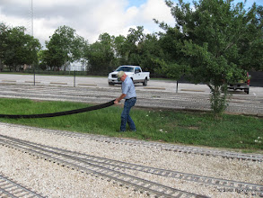 Photo: Art Morris stretching out the drain pipe in the ditch.   HALS Work Day 2013-1005 RPW