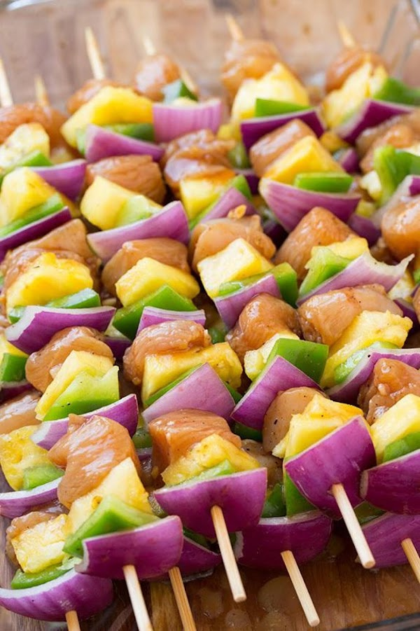 Season red onion and bell pepper with salt and pepper, then thread red onion,...
