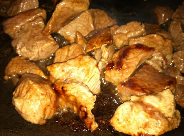Cut up the beef and pork into cubes.  Brown them in skillet with...