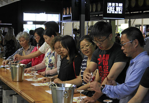 Chinese tourists sample wine at McGuigan Winery in the Hunter Valley, north of Sydney, Australia. Picture: REUTERS