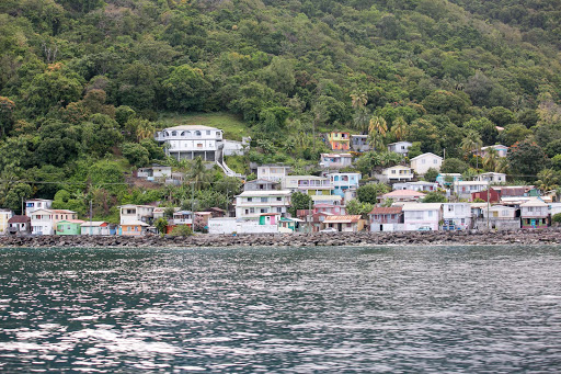 dominica-coastline-2.jpg - Houses enveloped by a tropical rainforest hug the western coastline of Dominica.