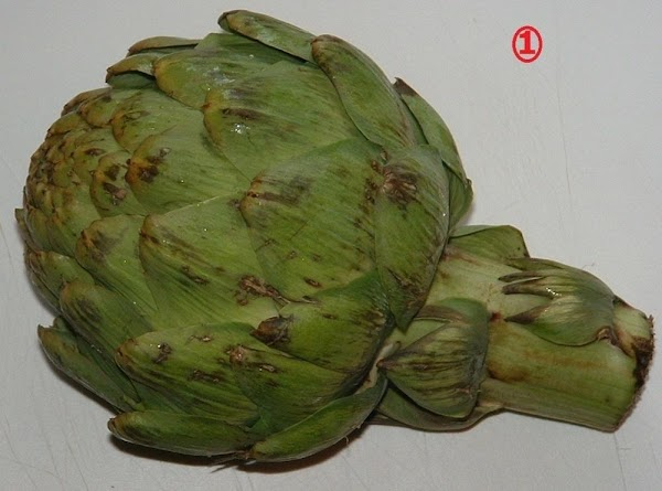 When you buy an artichoke, the leaves should be mostly snug to the head,...