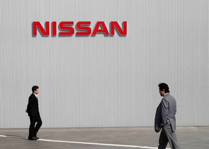 Men walk past a Nissan Motor logo at the company's global headquarters in Yokohama, south of Tokyo, Japan. Picture: REUTERS