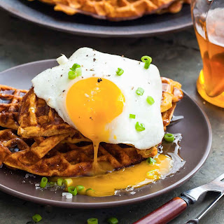 Sweet Potato Waffles with Fried Egg, Bacon, and Scallions.