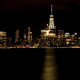 Manhattan Skyline at Night by Carol Ward - City,  Street & Park  Skylines ( manhattan skyline, pier a park, night time, manhattan, hoboken, freedom tower, hudson river )