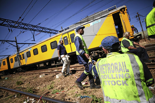 Metrorail workers at the scene of an accident in which two trains collided last month in Selby near the Booysens Station, south of Johannesburg. More than 900 train passengers have been injured since January.
