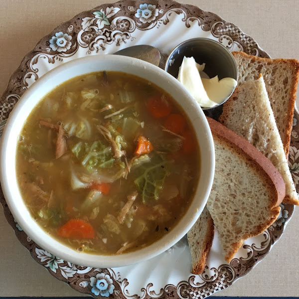 Bowl of Chicken, Cabbage and Jalapeño Soup with gluten free bread.