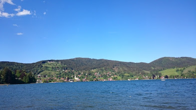 Photo: schliersee village and the schliersbergalm on the left side almost at the top of the schliersberg hill, the rohnberg is the hill in the middle ...