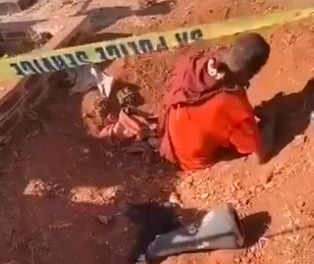 WATCH | Mob justice victim 'buried alive waist-deep' at Soweto cemetery - TimesLIVE