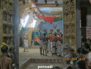 Photo: kaliyan and emperumAnAr outside paramapadha vAsal