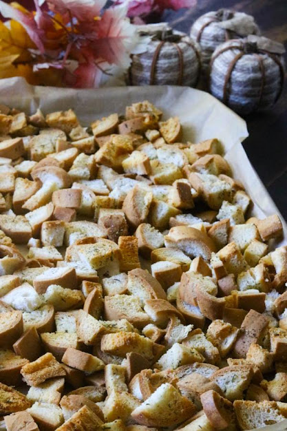 homemade gluten-free croutons on a cookie sheet with parchment paper