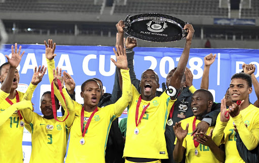 Bafana Bafana celebrate winning the Cosafa Cup Plate final at Peter Mokaba Stadium on Friday, while other teams are preparing for the kick off of the World Cup this week.