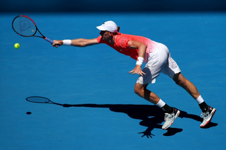 Kevin Anderson of South Africa plays a forehand in his first round match against Adrian Mannarino of France during day one of the 2019 Australian Open at Melbourne Park on January 14, 2019 in Melbourne, Australia.