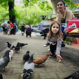 feeding the ... childhood by Catalin Nastase - City,  Street & Park  City Parks