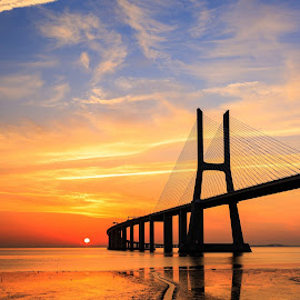 The Bridge and The Sun by Abílio Neves - Buildings & Architecture Bridges & Suspended Structures ( sky, sunrise, bridge, clouds, water )