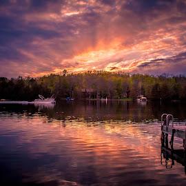 A Sunset on a Minnesota Lake by Gary Hanson - Landscapes Waterscapes ( minnesota, big thunder lake, 10000, sunset, sunrays, lakes, dock, remer,  )
