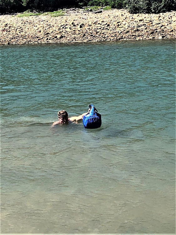 The author using his splash cover to float his rucksack across the Gonubie River