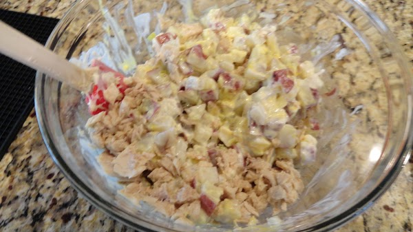 Add the tuna and boiled eggs to the potato mixture. Stir in the chopped...