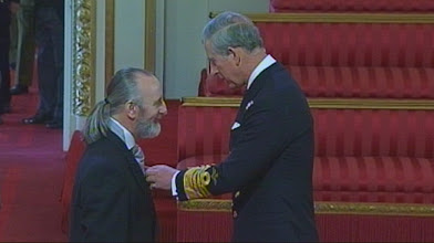 Photo: Michael being presented with his MBE by Prince Charles