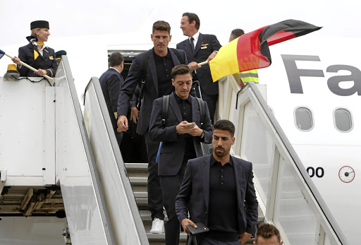 Germany's Sami Khedira, front, Mesut Özil and and teammates arrive in Moscow yesterday.