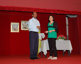 Photo: Miss Liew receiving the Scholarship Award