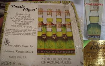 """Photo: Un vrai casse-tête ce puzzle cartusien !  400 pièces, 12""""3/4 par 19"""" d'alignement de bouteilles de Chartreuse verte. April House pour le marché US, années 1970 env."""