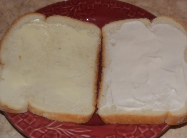 Spread the remaining butter on two of the bread slices.  Place face up...