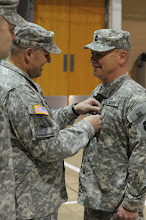 Photo: Master Sgt.  Brett Larson was awarded the Meritorious Service Medal and an NCO saber upon his retirement from the Minnesota National Guard in a 34th Combat Aviation Brigade ceremony May 21 at the Cedar Street Armory.