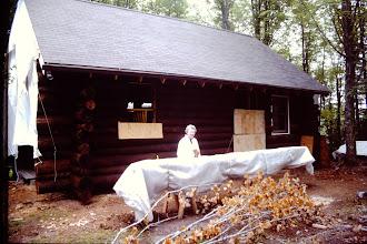 Photo: Lorraine outside the cabin.