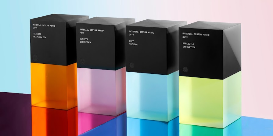 Four Material Design Award trophies made of colorful translucent blocks
