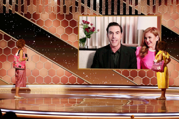"Sacha Baron Cohen, with Isla Fisher, accepts the Best Picture - Musical/Comedy award for ""Borat Subsequent Moviefilm"" via video in this handout photo from the 78th Annual Golden Globe Awards in Beverly Hills, California on February 28 2021. Picture: NBC HANDOUT"