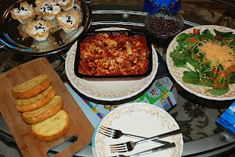 Photo: Look at all the goodies we have! The lasagna was great. Very flavorful and so easy! The bread was great too, perfectly garlicky and buttery :)