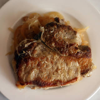 Baked Pork Chops with Apples and Sauerkraut.