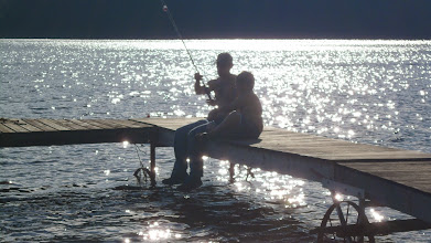 Photo: Jim helping Ethan fish on our last evening..