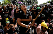 A University of KZN student is overcome with emotion during a protest over security  on campus.