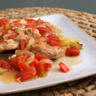 Pork Chops with Tomatoes and Garlic.