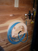 "Photo: There are four of these throughout the shop. Each with a 1/4""x 25' Flexeel hose hanging around'em..."