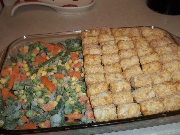 Place tater tots over the top of vegetables. You can place them in any...