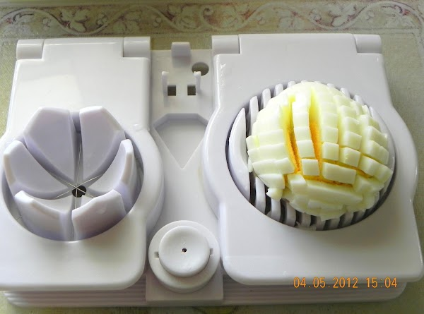 Hard boil your eggs and then slice them two ways in your egg slicer.