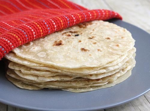 Take the tortillas and warm them for a few seconds in the microwave or...