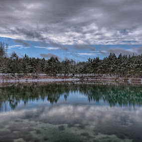 After The Storm by Brent Sharp - Landscapes Waterscapes ( water, clouds, reflection, winter, sky, green, snow, trees, lake, landscape, pond,  )
