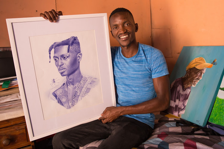 Themba Mkhangeli with one of his portraits in the tiny room where he works and lives in Nyanga.