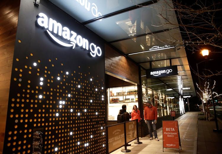 Amazon employees stand outside an Amazon Go brick-and-mortar grocery store in Seattle, Washington, the US. Picture: REUTERS/Jason Redmond