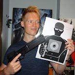 matt with the Robocop gun and paper target in Tokyo, Tokyo, Japan