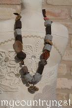Photo: collana roll di lana marrone e grigio