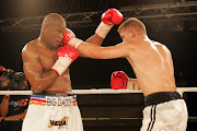 Osborne Machimana (white/gold/red/black trunks) and Pieter Cronje (white/navy/blue) during the South African Light Heavyweight Title match held at Emperors Palace Casino in Kempton Park, on November 12 2007.