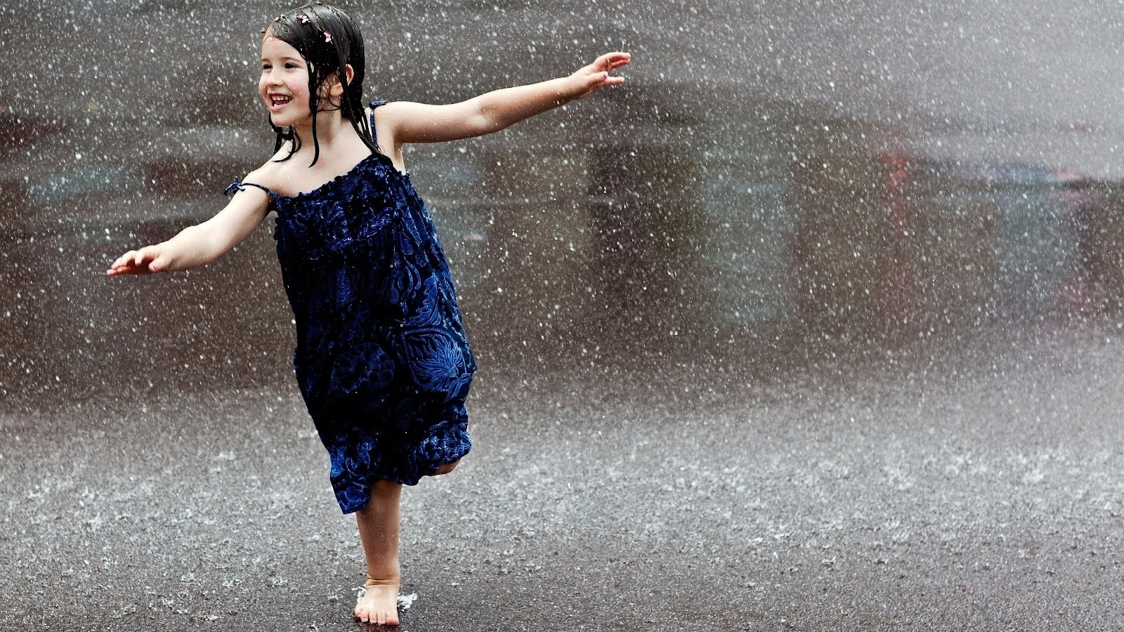 Little-Cute-Girl-Playing-In-Rain.jpg